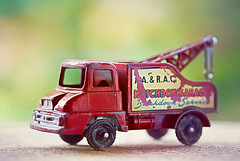The Old Tow Truck (Through Serena's Lens) Tags: macromondays junk macro matchbox towtruck toy red vintage miniature dof bokeh canoneos6dmarkii tabletop