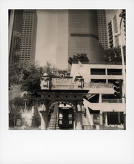 Angels Flight 2 (tobysx70) Tags: the impossible project tip polaroid bw blackandwhite expired instant film for sx70 type cameras impossaroid angels flight hill street downtown los angeles la california ca sign entrance funicular carriage shortest railway in world 298 feet 1901 bunker traffic light parking structure skyscraper plaza toby hancock photography