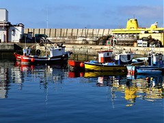 Puerto Mogán - fishing boats and yellow submarine = Gran Canaria (rossendale2016) Tags: canaria gran anchored reflection wines beer alcohol bars restaurants cafes maker ice colorful colourful colours colors metal pots hand rod road lone lobsters crabs fish fresh market sales shops cool fridge refrigerator cold store cooperative destination attraction tourist land port docks picturesque photograph photo excellent blue red yejjpw spain islands canary dock dry submarine yellow harbour onshore small boats fishing mogán puerto