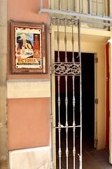 La Bodeguita de Málaga (Piedmont Fossil) Tags: malaga spain sign beer ad advertisement door bar bars gate wine