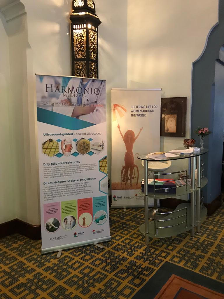 Mideast Scientific representatives talking to clinicians about the benefits of ultrasound-guided focused ultrasound surgery for treatment of uterine fibroids.