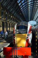 Slender Shadow (dhcomet) Tags: kings cross london train railway transport station azuma lner slender shadow couple pair traveller passenger trainshed paltform 8 eight