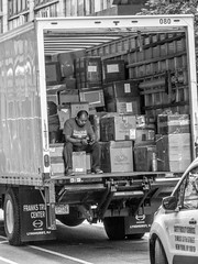 I'll'll unload the truck in a minute. Can't you see that I'm busy? (gddik) Tags: nyc newyorkcity work truck street mono blackandwhite blackwhite bw