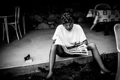 Malo's reading Charlie (PaxaMik) Tags: portrait portraitnoiretblanc charliehebdo charlie reading newspaper black blackandwhitephotos frenchportrait
