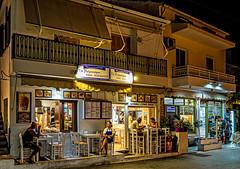 Gyros Cafe ( Fast Food - Greek Style) Kokkari Town - Samos ( Ricoh GR III Compact) (1 of 1) (markdbaynham) Tags: greece greek hellas hellenic greekisland greekholiday greeceaegean greektown greekaegean samos kokkari kokkaritown aerial food greeklife greekfood traditionalfood nightscape nightlife lowlight highiso beer hellenicbeer greekbeer craftbeer bottle beerbottle street streetlife urban urbanlife metropolis seafront harbour townharbour harbourfront ricoh ricohgr ricohdigital ricohgriii ricohcompact grd3 grdiii compact highendcompact valsamo apsc fixedlens prime primelens wideprime 28mm 28mmf28 ricohprime