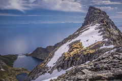 The mainland (Wim van de Meerendonk, loving nature) Tags: lofoten norway munken hike blue bright icefield ice landscape mountain mountainscape monumental nature outdoors outdoor panorama rock rocks sony sky scenic snow valley view wimvandem mountainside water