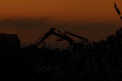Construction Sunset (lightersideofdark) Tags: dark outside outdoors cross sun settingsun endofdays red clouds sky darkclouds orange construction sunset