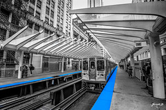 Blue Line (Jakesb_001.NEF) Tags: chicago downtown city walk black white blackandwhite monocrome street streetview people busy building urban urbanjungle urbanjunge usa illinois nikon tamron 7100 d7100 1024mm 1024 mm wide wideangle angle myange myeyes myview train trains crossing crosswalk cars car builings buildings summer blue line blueline waiting time station trainstation gray grayscale ride ticket walking stay