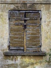 Closed shutters (Luc V. de Zeeuw) Tags: closed lock shutters ventspils latvia