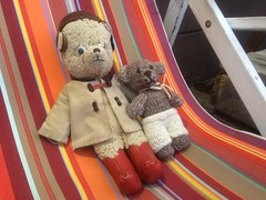 Paddington and the Deckchair 1. (raaen99) Tags: paddington paddingtonbear paddybear paddy teddy teddybear bear softtoy vintage toy vintageteddy vintageteddybear vintagetoy handmade softie plush cute cuddly soft scout scoutbear knitting knitted knittedtoy fairtrade fairtradebear scouthouse deckchair chair stripe wooden fabric canvas awning striped orange red yellow white rest seat sit sitting deck waiting await impatient southbank southbankcorniche corniche southbankpromenade artsprecinct southbankprecinct melbourne victoria australia antique collectable