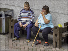 A couple is enjoying a relaxing time on a bench (Luc V. de Zeeuw) Tags: bench couple man woman ventspils latvia