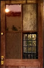 Reflected Door (loufsmith) Tags: cafe abandoned door sun sunset window wood glass