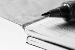 Moleskin notebooks and writing (Jan Macro Sleuth) Tags: smallmoleskinnotebook rollerballpen twoledtinypanellights writing macro blackandwhite autumn vrmicronikkor105mmf28gifed