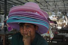 Hat seller 1/2 (efeardic) Tags: turkey colorful hats boy kid street photography portrait expression sony alpha 6000