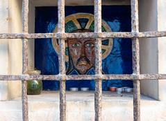 street vigil (savedbytheart) Tags: old town spain niche religion art window bars travel
