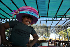 Hat seller 2/2 (efeardic) Tags: turkey colorful hats kid boy smile portrait street photography expression sony alpha 6000