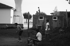Reflect (efeardic) Tags: street photography bnw black white boys playing football soccer sony alpha 6000