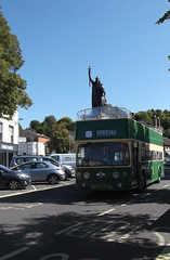 The Return of King Alfred (catrionatv) Tags: hampshire winchester broadway road roadmarkings chimneys houses shops firedearth trees cars carpark stgileshill statue lampposts bus atlantean leyland opentopbus kingalfred kingalfredbus kingalfredstatue return