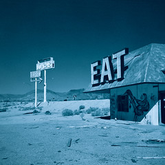eat (xpro). mojave desert, ca. 2016. (eyetwist) Tags: eyetwistkevinballuff mamiya ishootfilm eyetwist ishootkodak bw monochrome 50mm xpro crossprocessed kodak crossprocess 400 bw400 chromogenic tcn 6mf mamiya6mf kodaktcn400 mamiya50mmf4l 120 6x6 film analog mediumformat square chrome transparency analogue mamiya6 e6 emulsion c41 primes epsonv750pro filmexif california blue green teal socal betterlivingthroughchemistry lenstagger iconla abandoned halloransummit old decay diner eat forgotten roadsideamerica derelict mojavedesert logas west ruins desert american highdesert mojave sign typography type typographic signgeeks station restaurant gas gasolone
