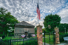 Pics from Pittsburgh #16 (tquist24) Tags: fortpitt fortpittblockhouse hdr nikon nikond5300 outdoor pennsylvania pittsburgh pointstatepark bench blockhouse clouds fence flag flagpole gate geotagged grass historic lawn outside park sky tree