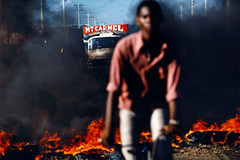 (lia.abramian.2022) Tags: afrocaribbean camion cyclist cycliste election extérieur exterior faces flame flamme fumée haïti haitiannationality haïtiennationalité lorry manallages masculin noirafrocaraïbe portauprince processed rue smoke street violence
