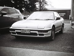 1989 Honda Prelude (photo 2) (Matthew Paul Argall) Tags: jcpenneyelectronicstrobepocketcamera 110 110film subminiaturefilm lomographyfilm 100isofilm blackandwhite blackandwhitefilm car vehicle automobile transportation honda hondaprelude