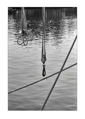 Ropes in morning sunlight (K.Pihl) Tags: norway leicam5 hc110b800 ropes hook monochrome skien overexposedoverdeveloped water bw pellicolaanalogica schwarzweiss kodaktrix400200 blackwhite film analog