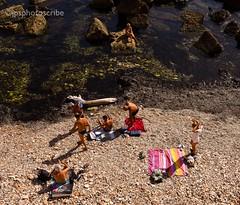 Swimming off the rocks (stewardsonjp1) Tags: ocean sea italy men beach swim women rocks bikini bathe sicily trunks swimsuit ortigia isola towel