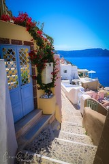 Stairs in Oia (corineouellet) Tags: architecture flowers exposure composition canonphoto travel greece santorini oia mountains stairs cityscene cityscape city seascape ocean oceanview