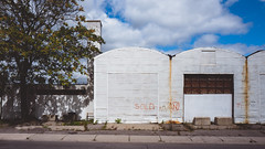 for.the.time.being (jonathancastellino) Tags: toronto abandoned derelict leica q graffiti sold cloud tree sky clouds hangar shape light sidewalk series shadow