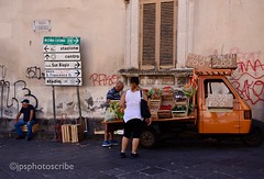 Fruit and veg (stewardsonjp1) Tags: bench graffiti acireale italy sicily town streetlife streetscene streetphotography woman man truck veg vegetables fruit
