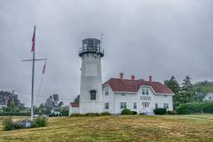 Chatham Light House (gabi-h) Tags: chathamlighthouse capecod lighthouse buildings flag coastguard white red gabih rescue historical vintage massachusetts