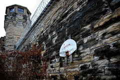 Hoops Fan for Life (Goromo) Tags: oldjolietprison prison abandoned 18582002 basketball backboard hoop recreation prisonwalls razorwire tower guardtower desolate deteriorated jolietillinois shotbywayne processedbysharon