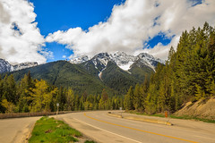 Driving In  Kootenay National Park. (http://fineartamerica.com/profiles/robert-bales.ht) Tags: canada forupload landscape places projects scenic toworkon sky natural nature park bc travel landmark evergreen outdoors columbia kootenay rockies mountains canadian british trees clouds peak panorama panoramic national forest mountain rocky alberta beauty jasper banff rocks sunlight icefield range robertbales canadianrockiesmountains kooktenaynationalpark britishcolumbia
