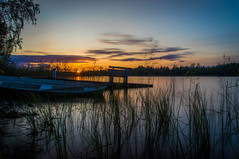September sunset (mabuli90) Tags: lake water boat dock grass sunset sky clouds longexposure finland tree forest sun night