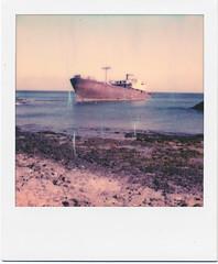 Lanzarote IX (Ulla M.) Tags: polaroid polaroidoriginals pola lanzarote atlantik welle wave strand beach analog analogue analogphotography instantfilm instant sofortbild wrack wreck umphotoart coast küste felsen