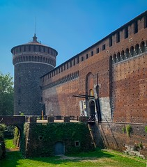 Across the Moat - Explore (mswan777) Tags: wall castle brick moat bridge history tower red green sky outdoor apple iphone iphoneography mobile milan italy architecture defense tall