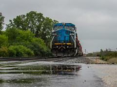 The Devil in Blue (Elijah J. Jackson (EJ)) Tags: train transportation trains tracks technology ge dash8 diesellocomotives diesel illinoiscentral cn canadiannational generalelectric widecab bluedevil rain rainy rainyday gloomy dreary freighttrain photography photo railroad railroadphotography railroadtracks rails railyard classic