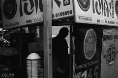 Untitled (D. R. Hill Photography) Tags: thailand bangkok thai asia southeastasia city urban travel street streetphotography blackandwhite monochrome grain film analog analogue 135 35mmfilm jch jchstreetpan400 streetpan japancamerahunter contax contaxg1 g1 carlzeissplanar45mmf2 zeiss 45mm primelens fixedfocallength silhouette man person