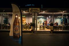 Island nights...... (Dafydd Penguin) Tags: beer drink advert bill board flyer bottle after dark night shots bar cafe street salamis saronic gulf greece mediterranean sea water leica m10 35mm summicron f2 asph