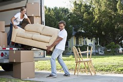 Young couple moving house (elsuper900) Tags: movinghouse couple movingvan youngadults truck boxes happiness realestate standing lifting moving teamwork lookingdown smiling cheerful stacked loading unloading fulllength cardboardboxes helping carrying furniture sofa twopeople youngcouple youngman youngwoman man woman caucasian 20s 2025years 2530years casual jeans outdoors driveway residentialstructure house frontyard lawn grass relocation adults photography colorimage horizontal people sc0482