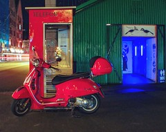 Shiny Vespa, old phone booth & futuristic toilet. Bergen, Bryggen.