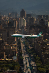 New Arrivals (Peter Stewart Photography) Tags: songshan airport taipei taiwan eva air a330 approach landing cityscape flyover highway aerial buildings low rise aviation