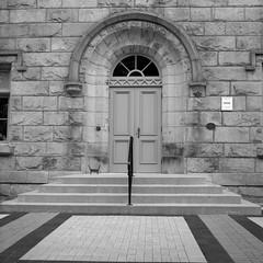 Entrance (Alex Luyckx) Tags: milton ontario canada downtown urban town historic historicdowntown architecture buildings random wandering frankeheidecke rolleiflex rolleiflex28f tlr 120 mediumformat 6x6 square carlzeiss carlzeissplanar80mm128 foma fomapan200 asa200 kodak kodakhc110 hc110 dilutionh 163 epsonv700 adobephotoshopcc bw blackwhite film filmphotography believeinfilm filmisalive filmisnotdead