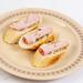 Sliced Baguettes served with Ham
