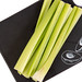 Top view of Celery Sticks on the black tray