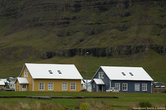 Colourful Houses in Seydisfjordur (David J. Greer) Tags: travel adventure sailtrainexplore rubicon3 explore experience voyage journey iceland seydisfjordur fjord yellow grey house green grass mountainside vista landscape silver roof