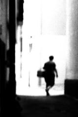 A grain study (Nikon F80) (stefankamert) Tags: film grain street woman nikon f80 slr voigtländer voigtlander ultron kodak trix stefankamert noir noiretblanc blackandwhite blackwhite bw alley silhouette 0718