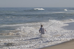 Man vs. Sea (brucetopher) Tags: fishing surfcasting fish wave surf cast casting throw break breakers man fisherman sea ocean tide sport sportsman outdoor outdoors nature natural summer distance horizon beach sand wet wash overcome extreme