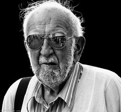 Without reflection, we go blindly on (Neil. Moralee) Tags: neilmoralee neilmoralee2019 man face portrait mirror glasses reflection old mature wisdpm experienced wrinkles beard hair black white blackandwhite bw blackwhite blackbackground neil moralee olympus omd em5 street candid people male person strong